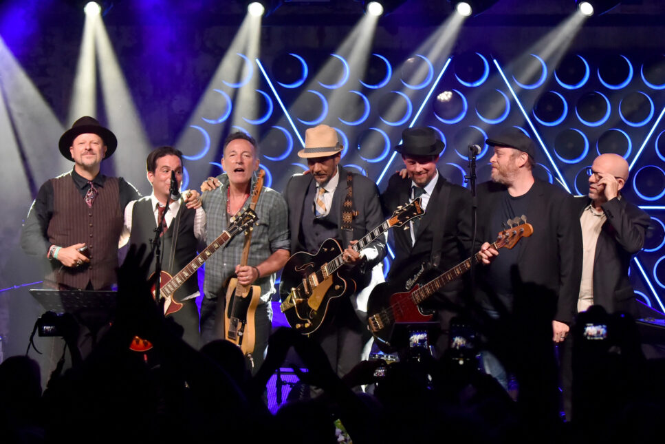 Bruce Springsteen and the members of the Tangiers Blues Band onstage.