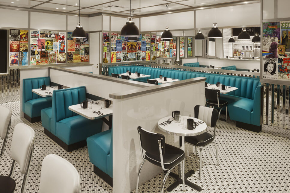 Black and white retro diner with bright turquoise booths.