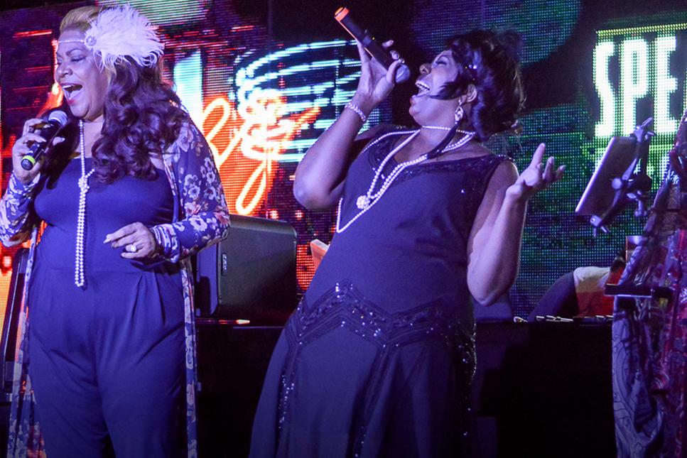 Women singing.