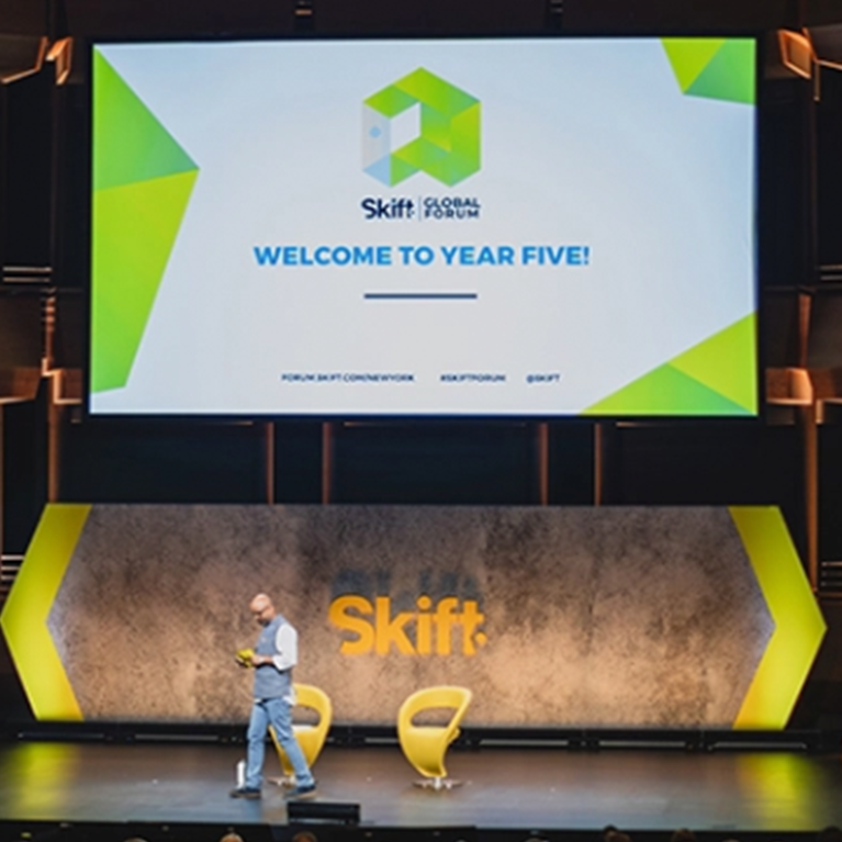 Rafat Ali on stage at Skift Global Form